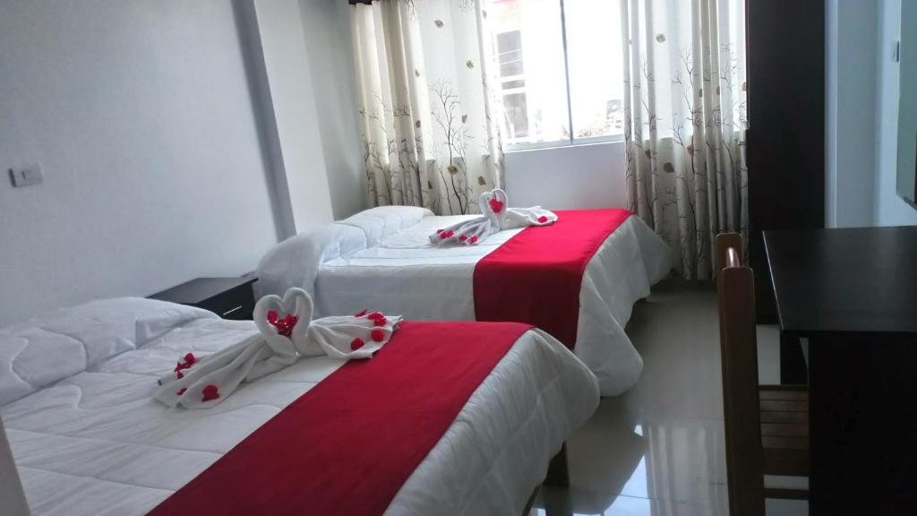 A bed or beds in a room at Hotel Lucero