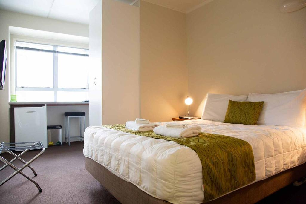 A bed or beds in a room at City Lodge Accommodation
