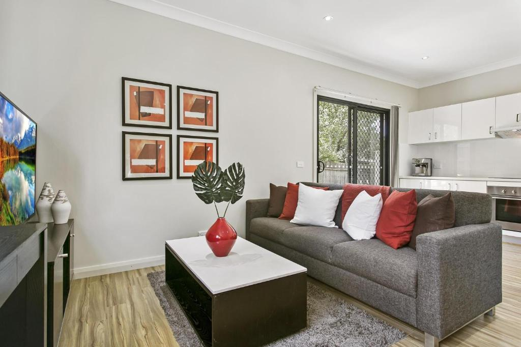 A seating area at Family-friendly hideaway in quiet suburb