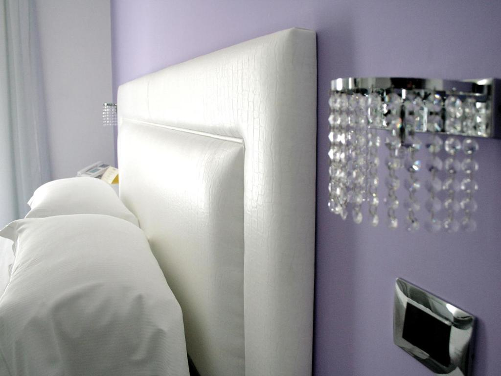 A bed or beds in a room at Hotel Bruman