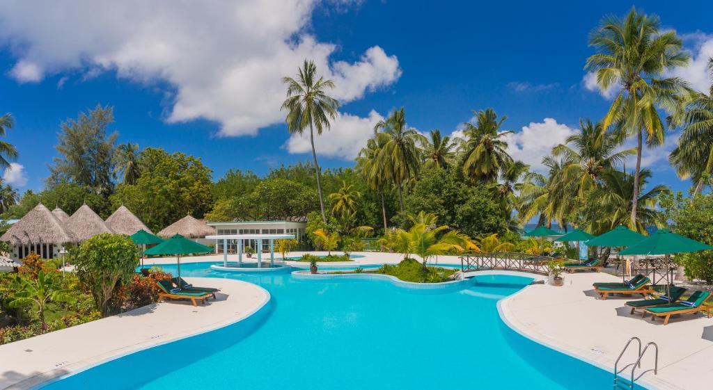 The swimming pool at or close to Equator Village Resort