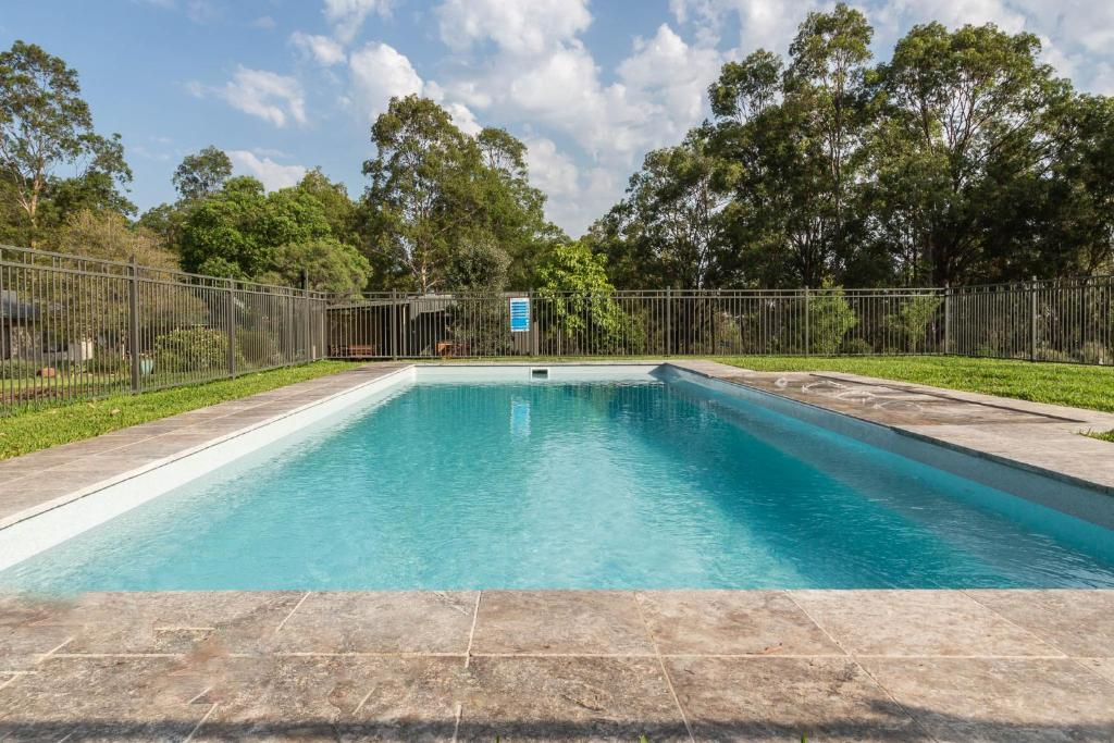 The swimming pool at or near Hermitage Hideaway