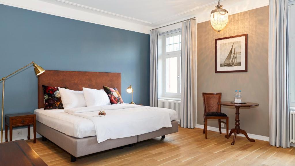 Ein Bett oder Betten in einem Zimmer der Unterkunft Blue City Boutique Hotel