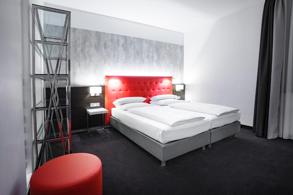 A bed or beds in a room at Select Hotel Berlin The Wall