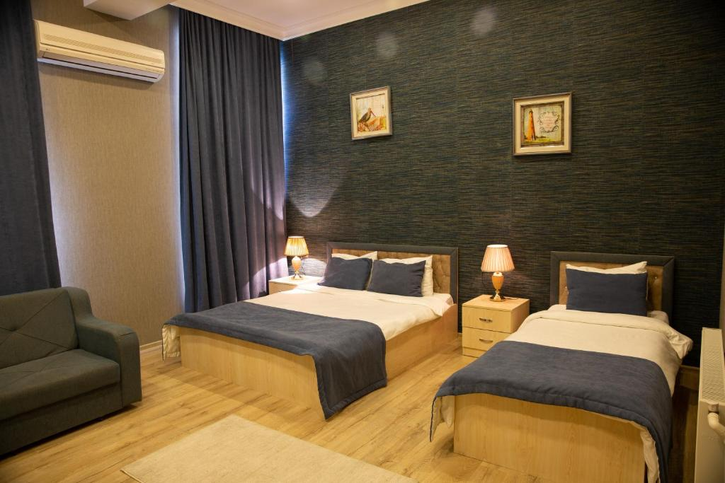 A bed or beds in a room at Life Holiday Baku