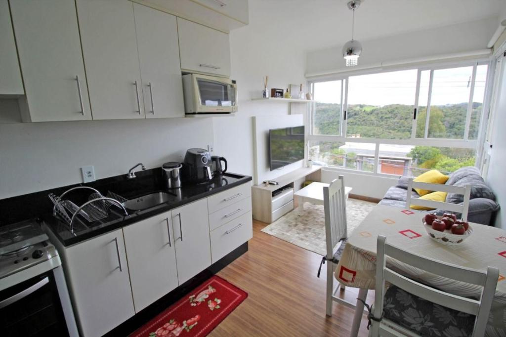A kitchen or kitchenette at Vista do Vale! SKY + PFC + WIFI 120MB