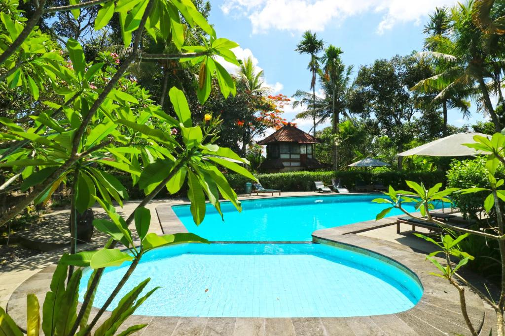 The swimming pool at or close to Melati Cottages