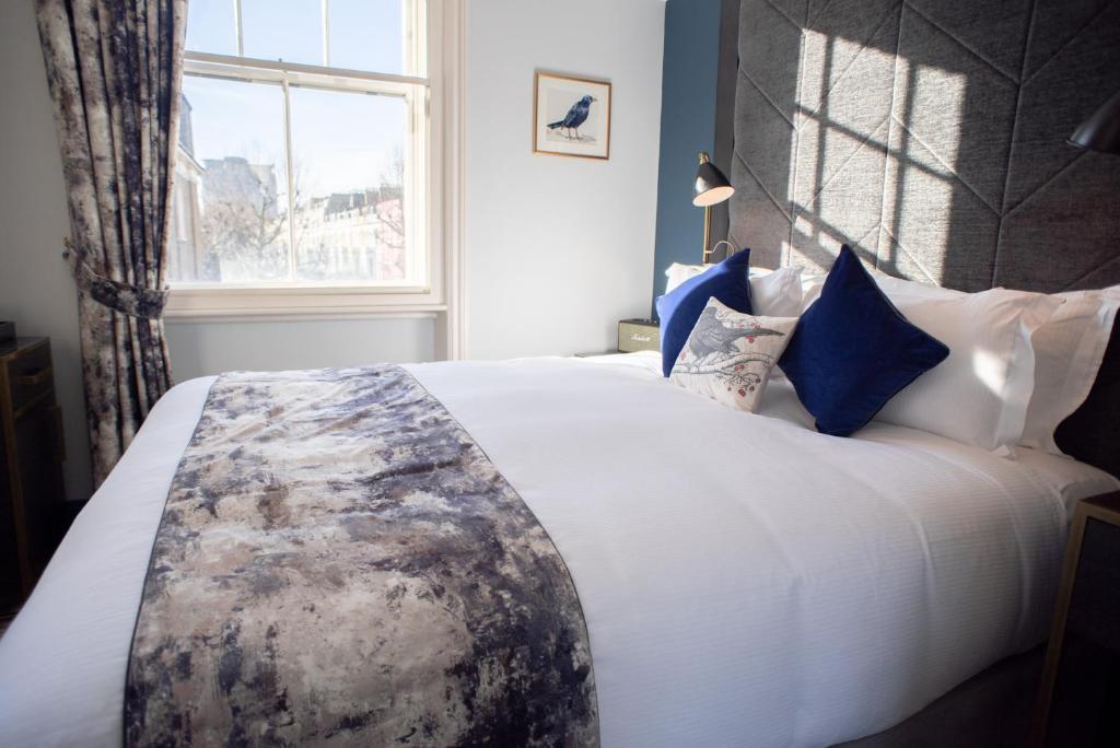 Ein Bett oder Betten in einem Zimmer der Unterkunft Blackbird