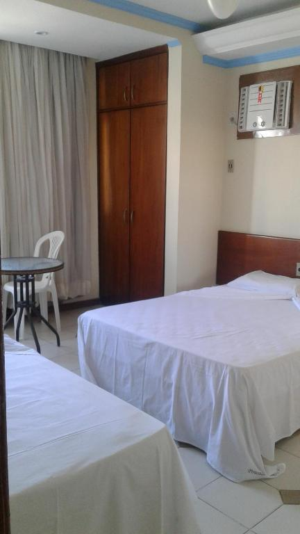 A bed or beds in a room at POUSADA SALVADOR