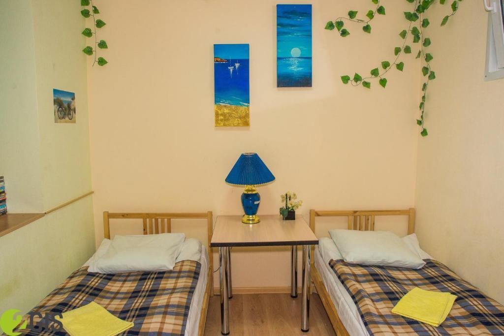 Кровать или кровати в номере Hostel Svoboda 9 Yaroslavl