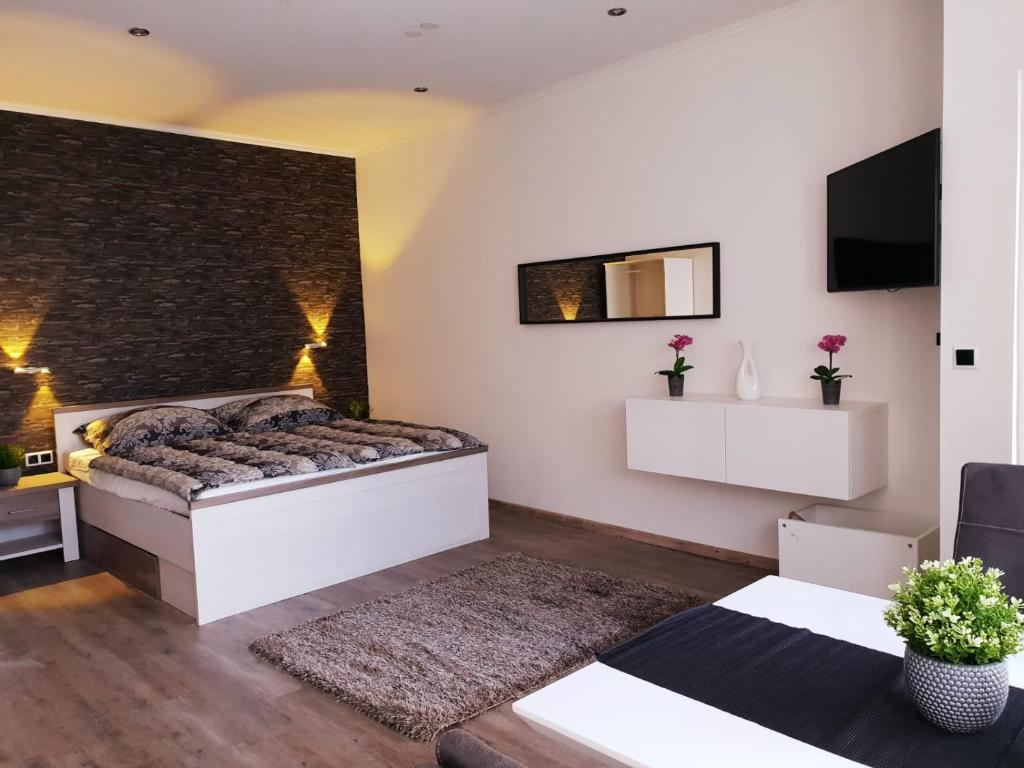 Ein Bett oder Betten in einem Zimmer der Unterkunft Csery