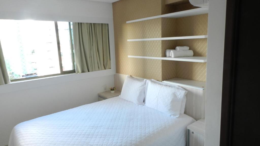 A bed or beds in a room at Flat Acolhedor 2 Qtos Boa Viagem