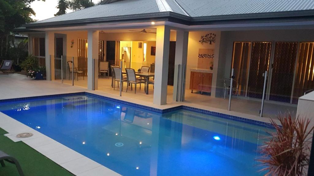 The swimming pool at or near Eden Trinity Beach Lagoon Front House