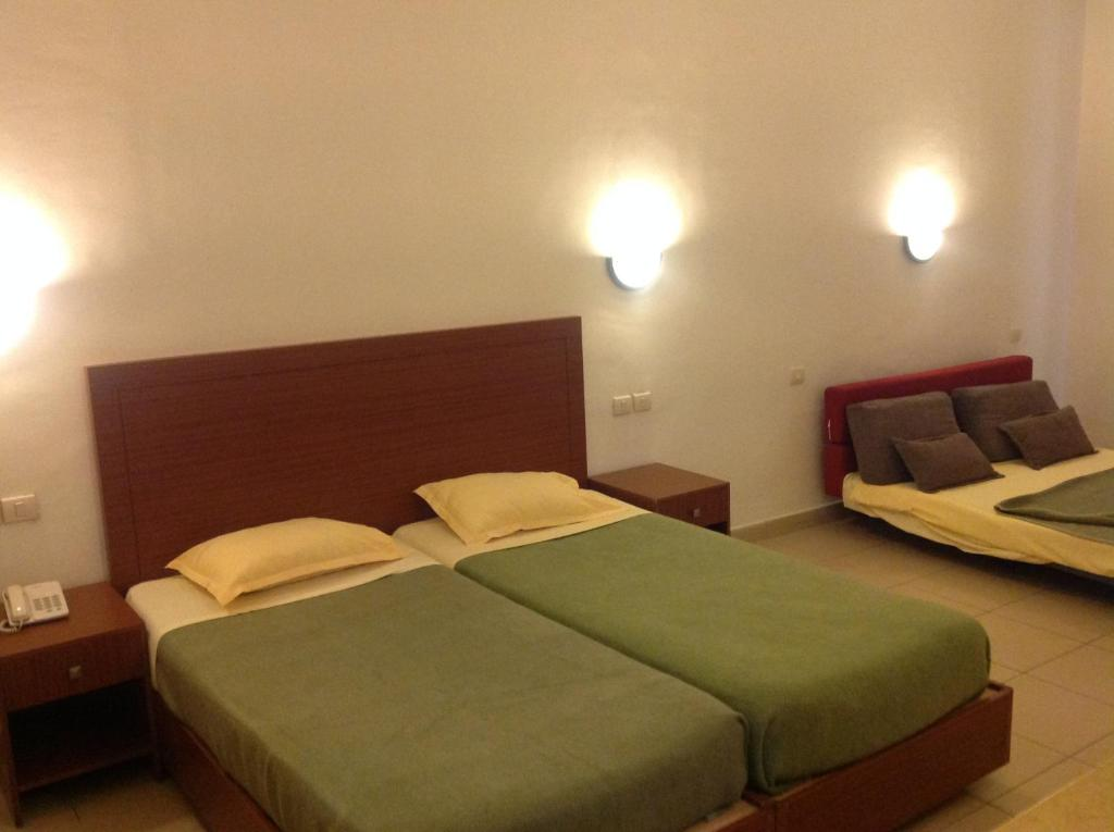 A bed or beds in a room at Dar Khayam