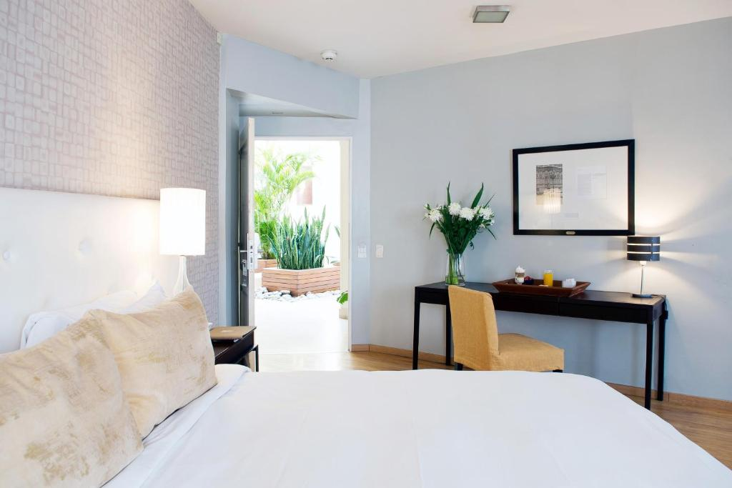 A bed or beds in a room at Nuss Buenos Aires Soho