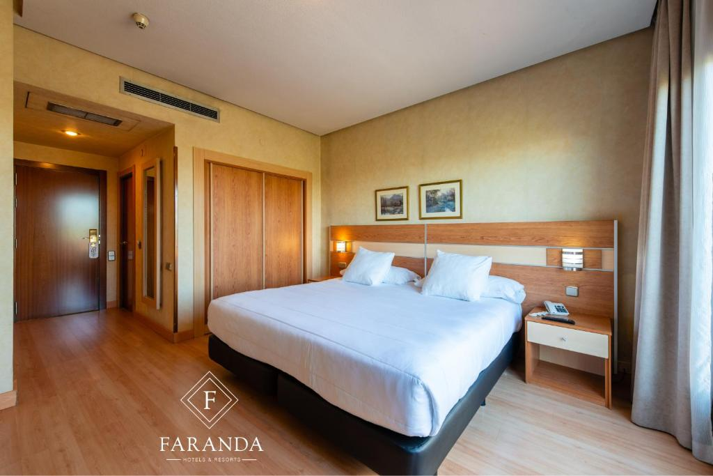 A bed or beds in a room at City House Hotel Florida Norte By Faranda
