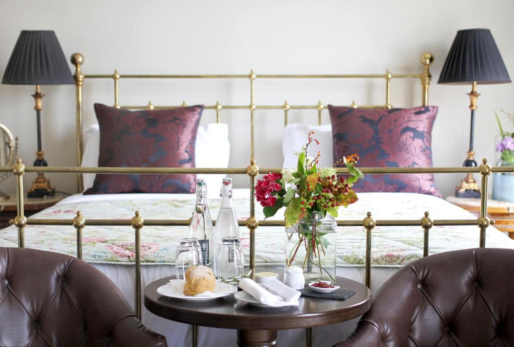 A bed or beds in a room at No.1 Pery Square Hotel & Spa
