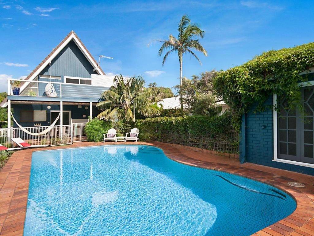 The swimming pool at or near Birdsong Beach House