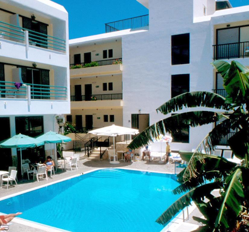 The swimming pool at or close to Poseidon Hotel and Apartments