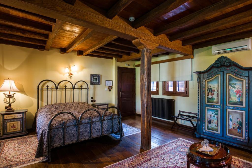 Ένα ή περισσότερα κρεβάτια σε δωμάτιο στο Boutique Hotel Kokkino Spiti