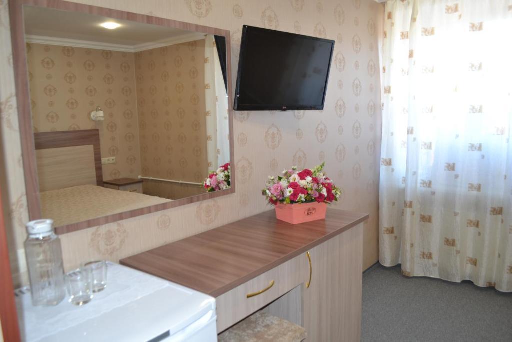 Телевизор и/или развлекательный центр в Гостиница Визит