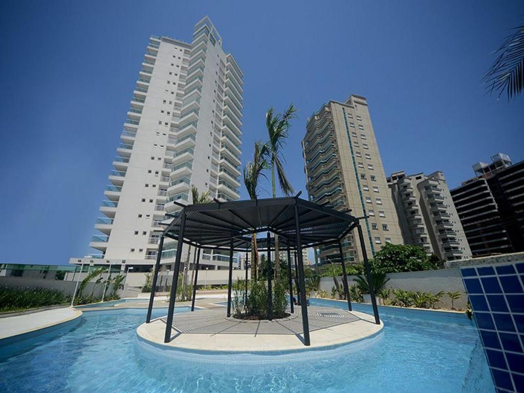 The swimming pool at or near Apartamento de temporada na Praia da Enseada - Guarujá