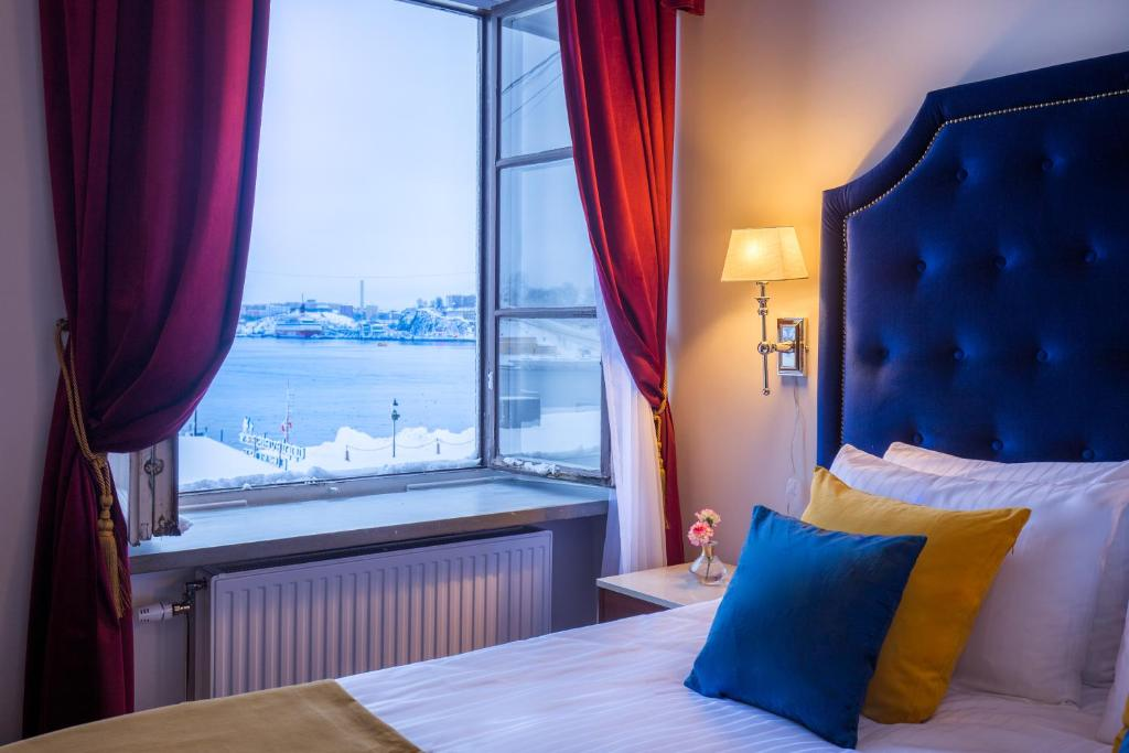 A bed or beds in a room at Hotel Gamla Stan, BW Signature Collection