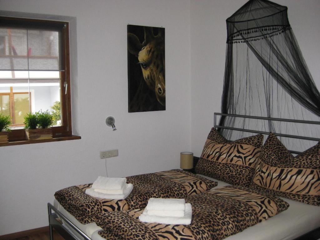 Een bed of bedden in een kamer bij Apart Via Claudia Augusta