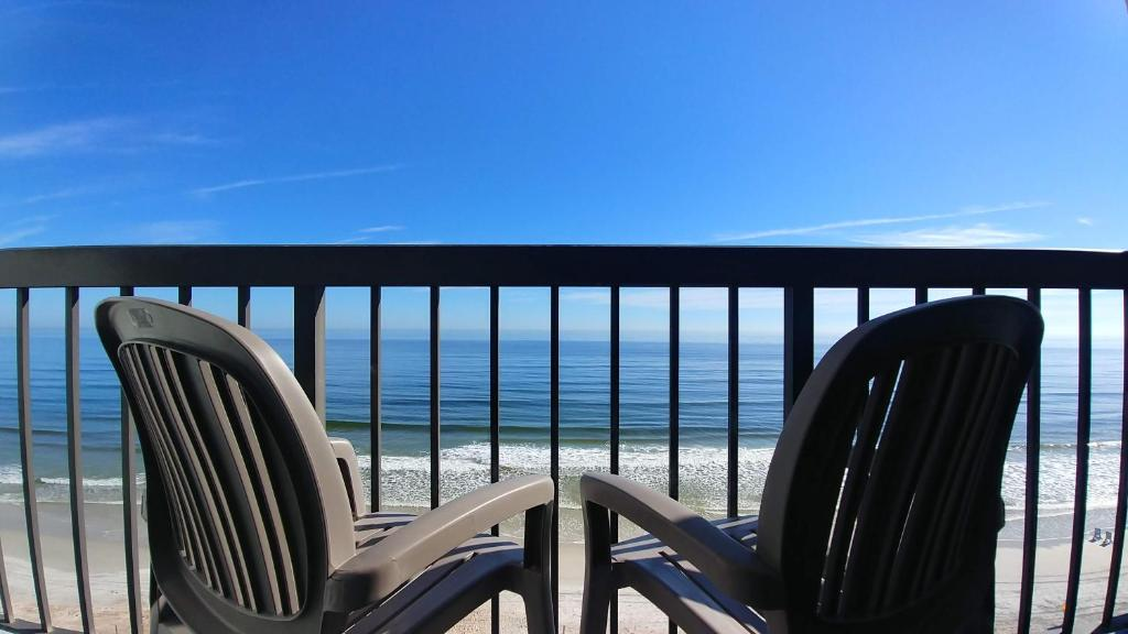 A balcony or terrace at Tropical Winds Resort Hotel