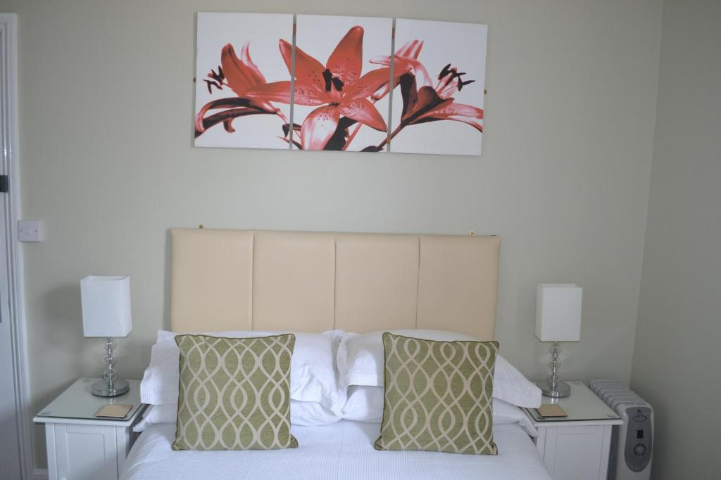 A bed or beds in a room at The Grange