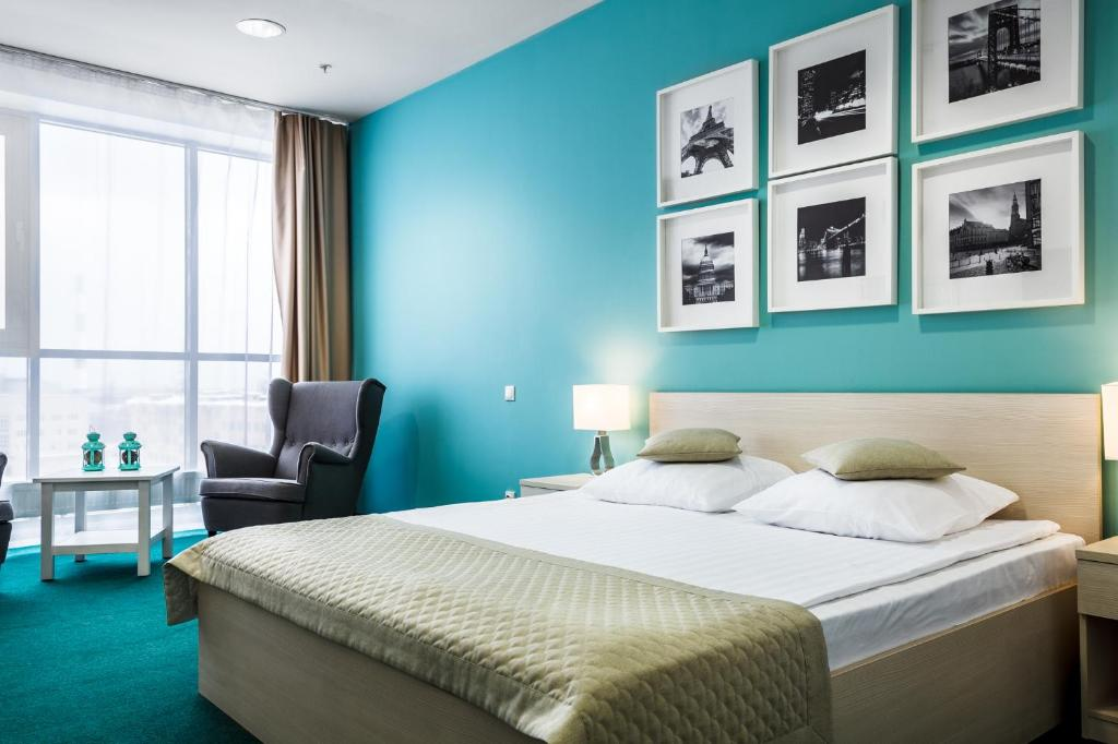 Кровать или кровати в номере Отель Каскад