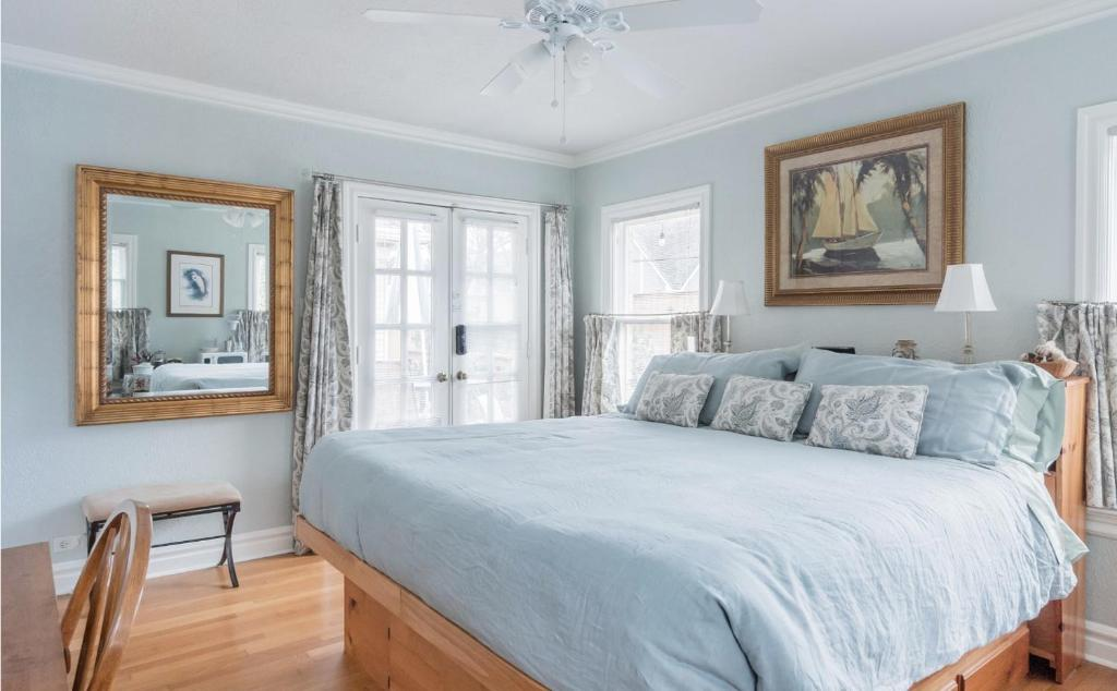 A bed or beds in a room at Whimsical Charm at Historic M-Streets Suite