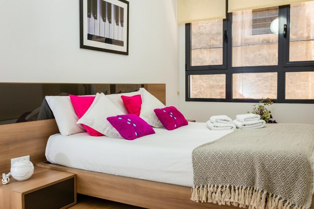 Cama o camas de una habitación en Apartamento Comedias