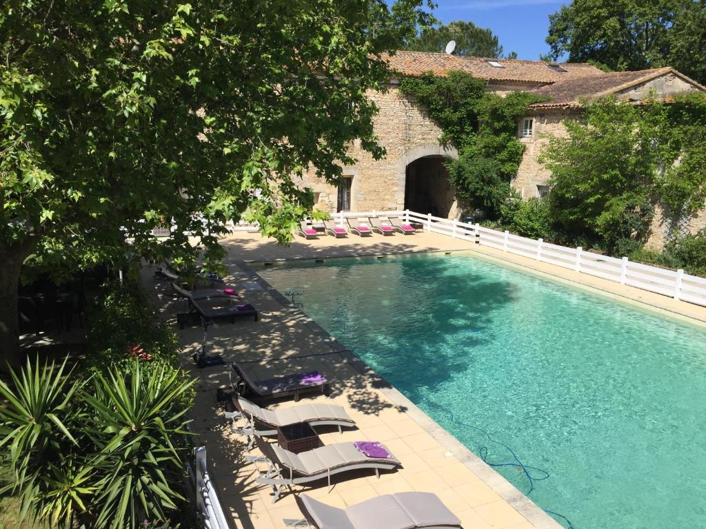 The swimming pool at or near Hotel Mas De Galoffre