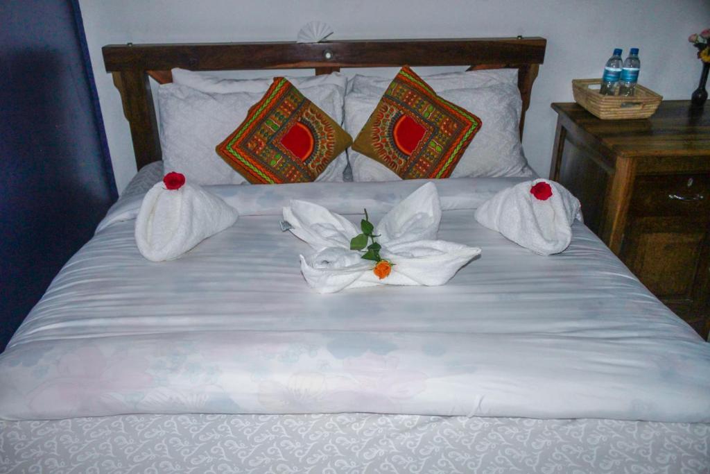 Posteľ alebo postele v izbe v ubytovaní Sinzia Villas
