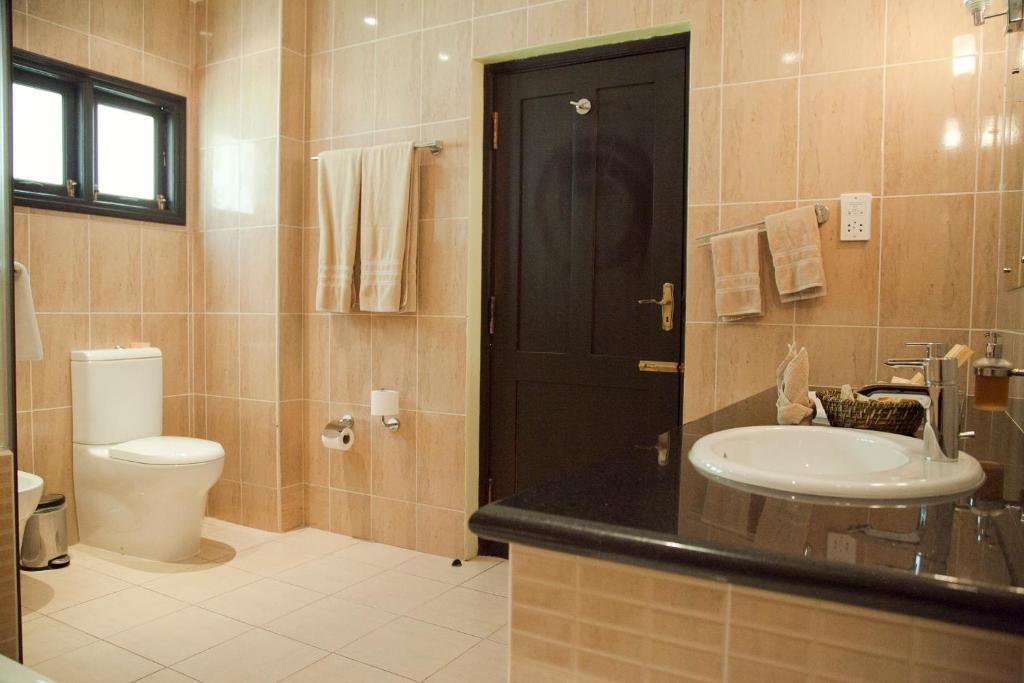 Een badkamer bij Oasis Hotel Restaurant & Spa