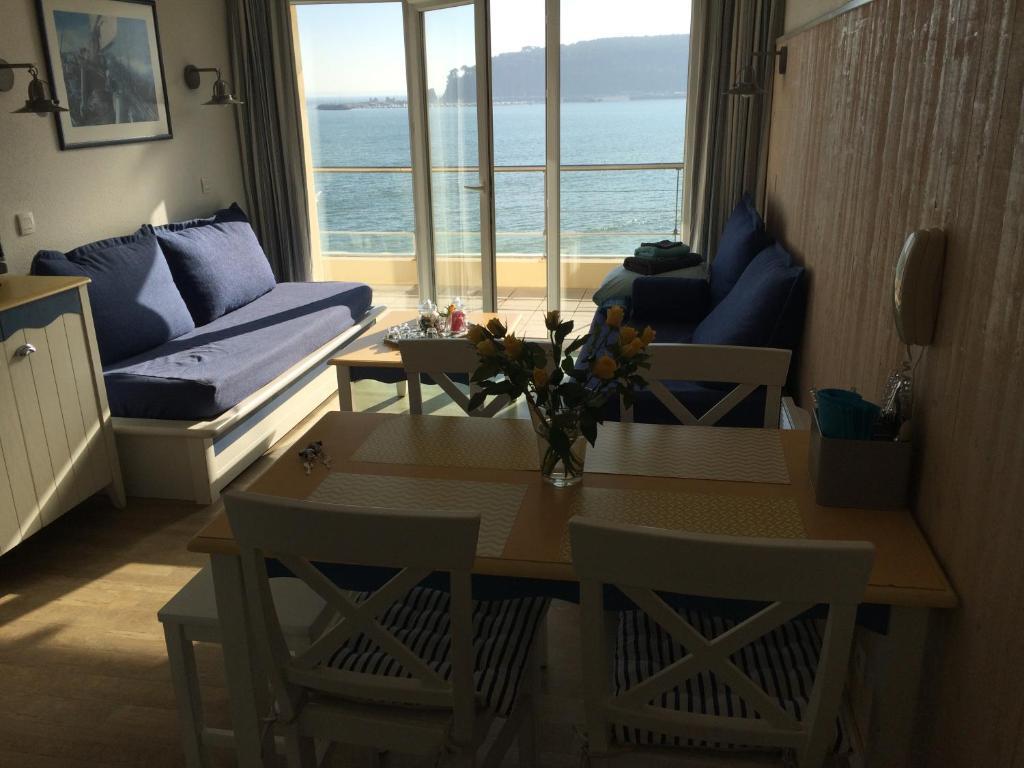 A seating area at Cap Morgat chez Jean