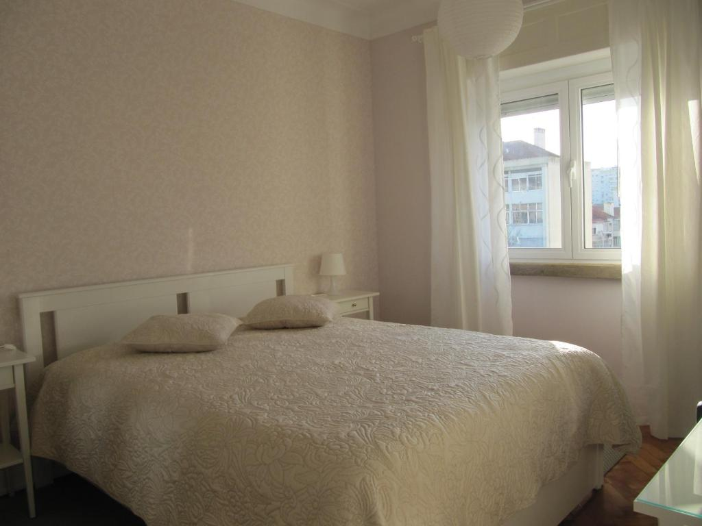 A bed or beds in a room at Beautiful Lisbon