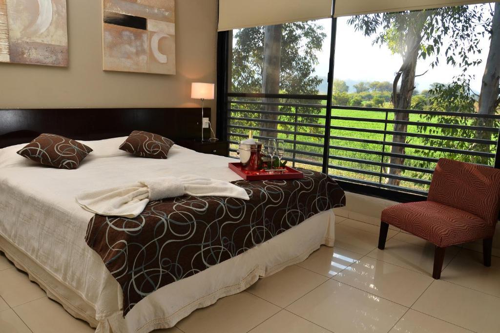 Una cama o camas en una habitación de La Wet