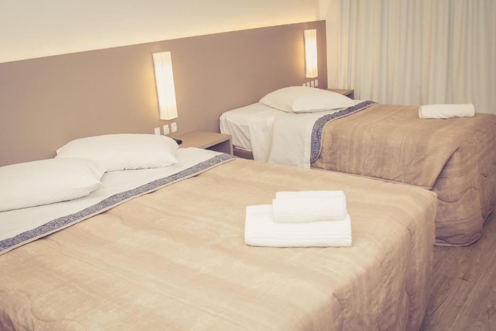 A bed or beds in a room at HOTEL LUAR ATLANTICO