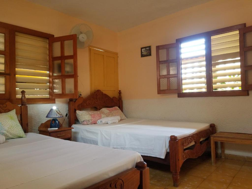 A bed or beds in a room at Hostal Casa Mia