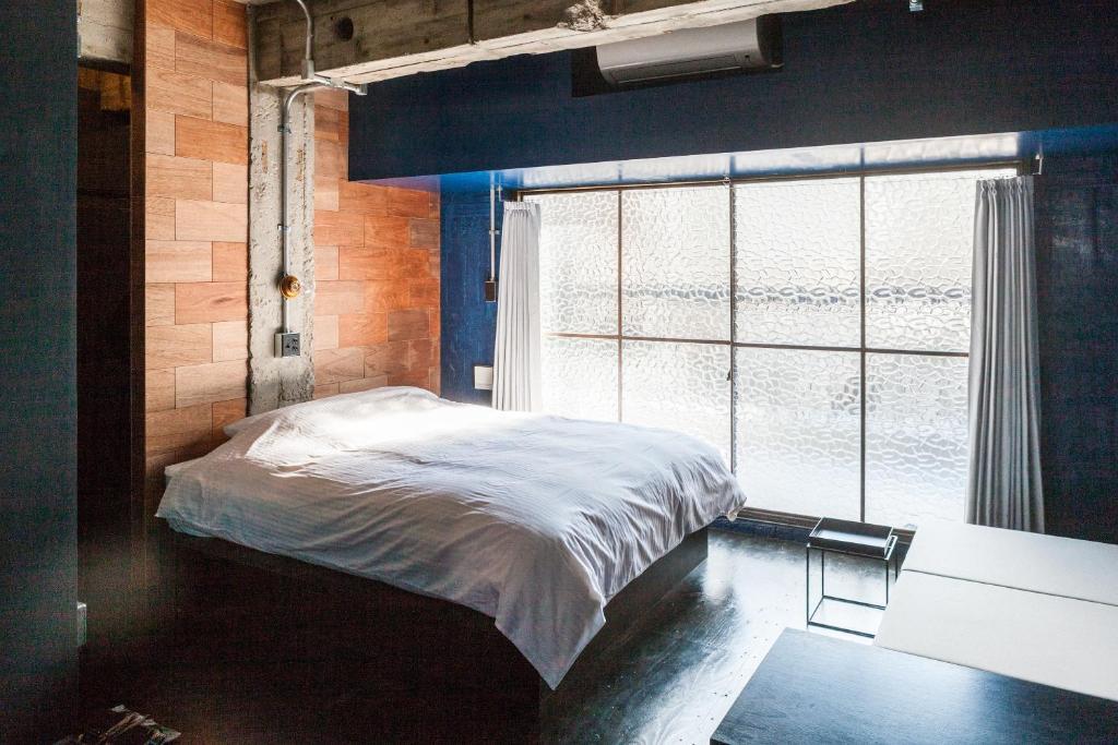 Area Inn Fushimicho Fukuyama Castle Sideにあるベッド