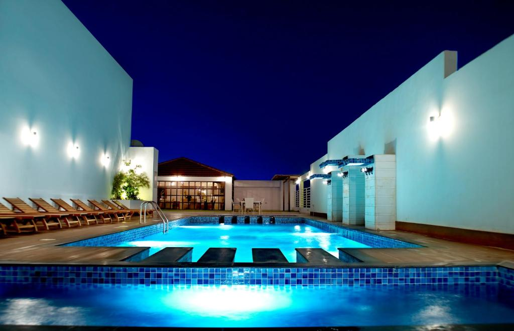 The swimming pool at or near Ista Suites Seef