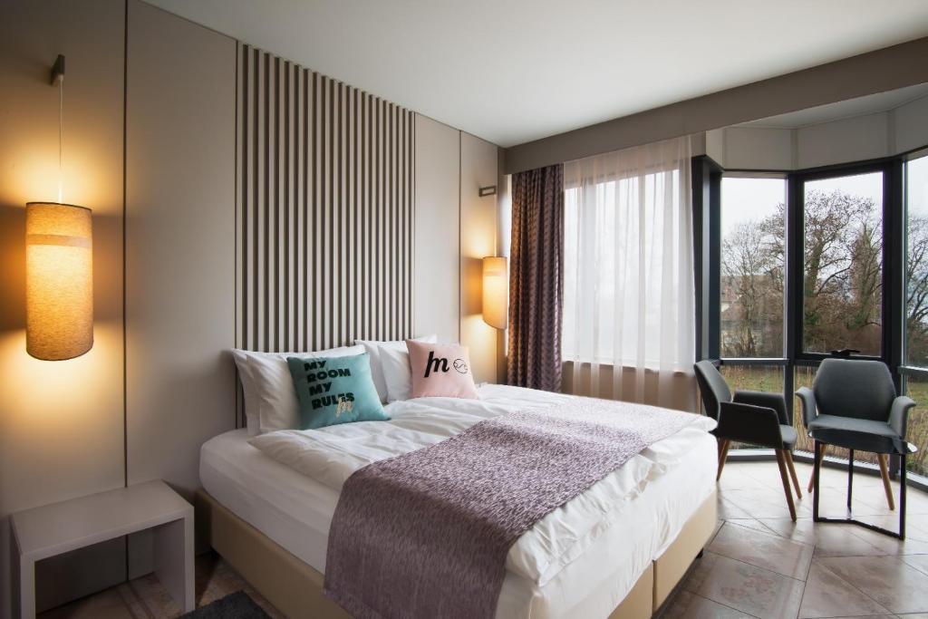 Ein Bett oder Betten in einem Zimmer der Unterkunft Best Western SeePark Hotel Murten
