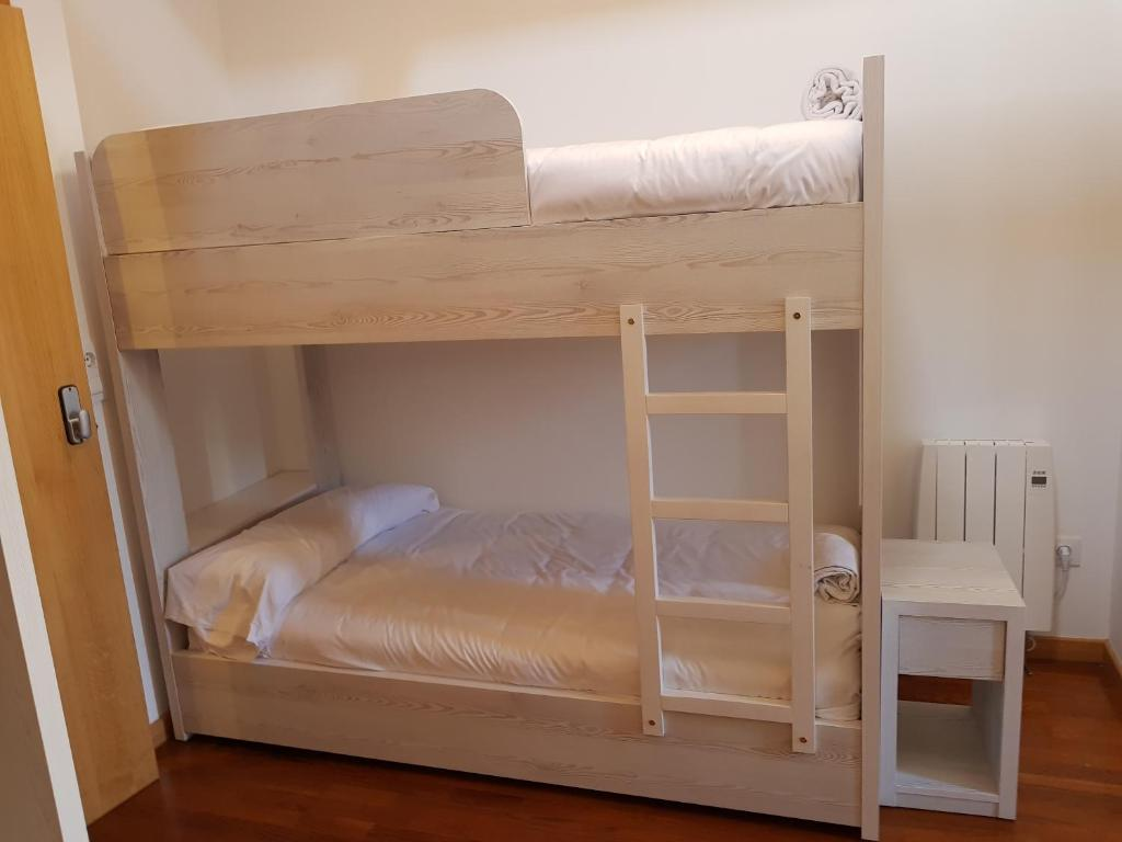A bunk bed or bunk beds in a room at Albergue A Salazon