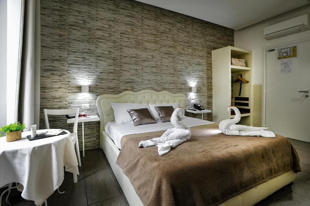 Un ou plusieurs lits dans un hébergement de l'établissement Vatican Relax Guesthouse