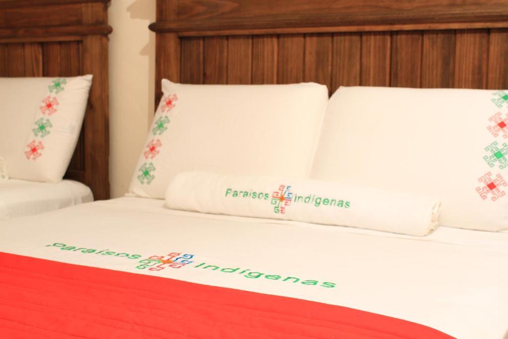 A bed or beds in a room at Ecolodge & Villas Tziscao: Lagos de Montebello - Tziscao