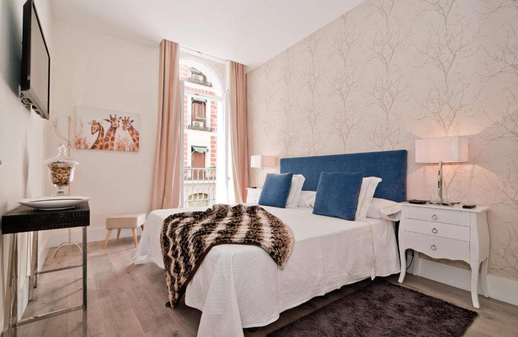 A bed or beds in a room at Behap Madrid Puerta del Sol