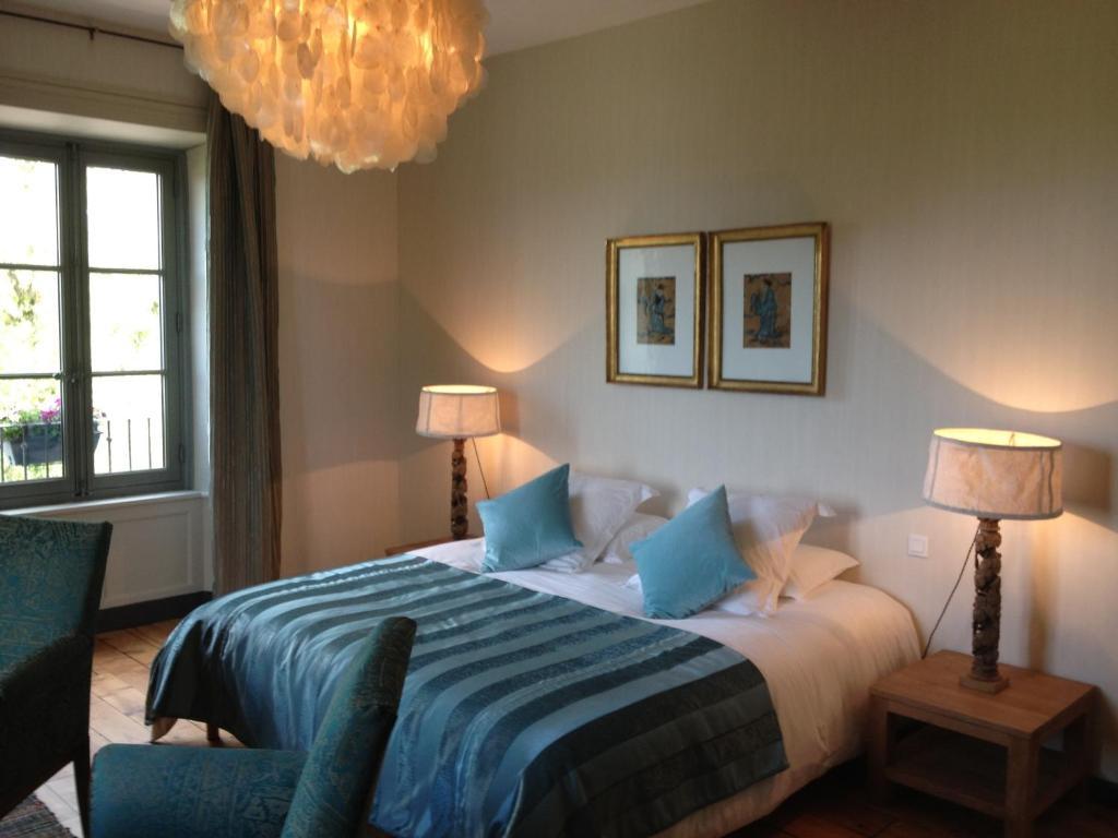 Un ou plusieurs lits dans un hébergement de l'établissement Le Rézinet - Chambres d'Hôtes