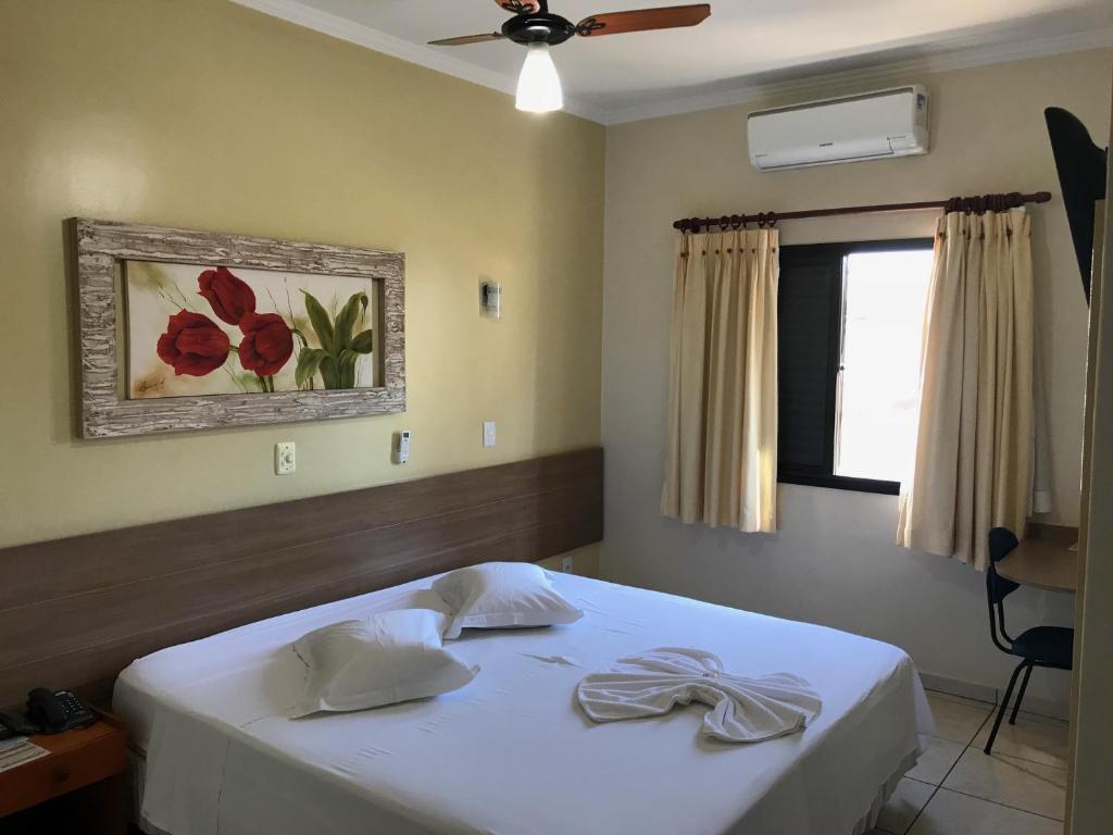 Cama ou camas em um quarto em Hotel Boa Vista